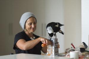 Penguin helping Sam Bloom grate carrots