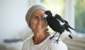 Sam Bloom with Penguin the Magpie on her shoulder