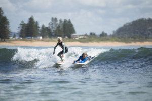 Sam Bloom and Rueben Bloom surfing