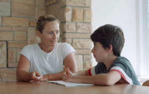Sam Bloom helping her son Olie with his homework