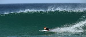 Sam Bloom surfing